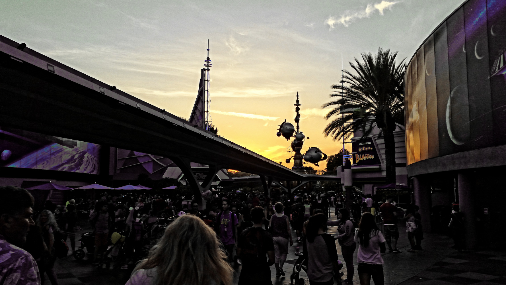 Walking through Tomorrow Land at sunset