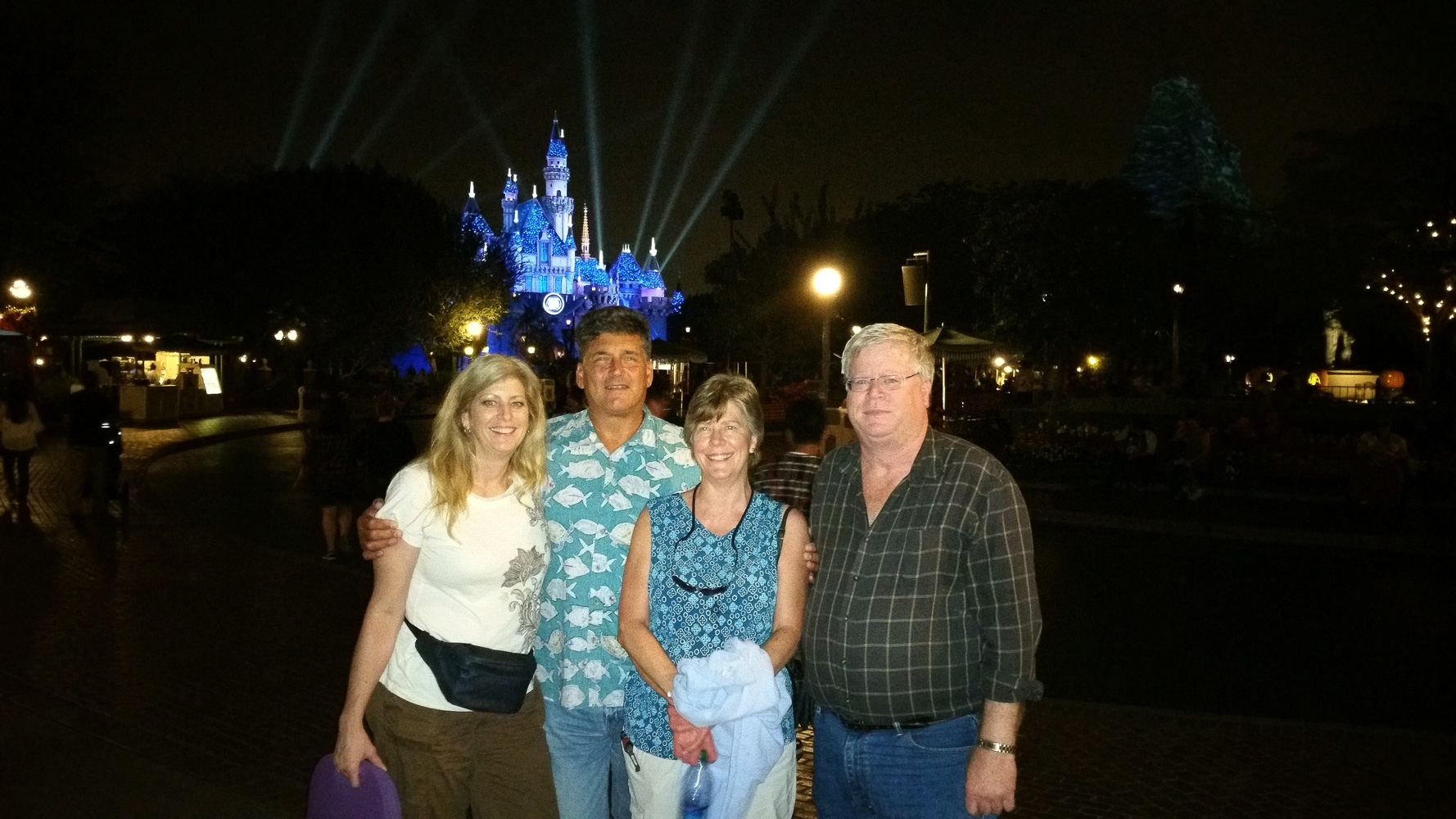 My sisters and brother-in-law in front of Slleping Beauty's castle.