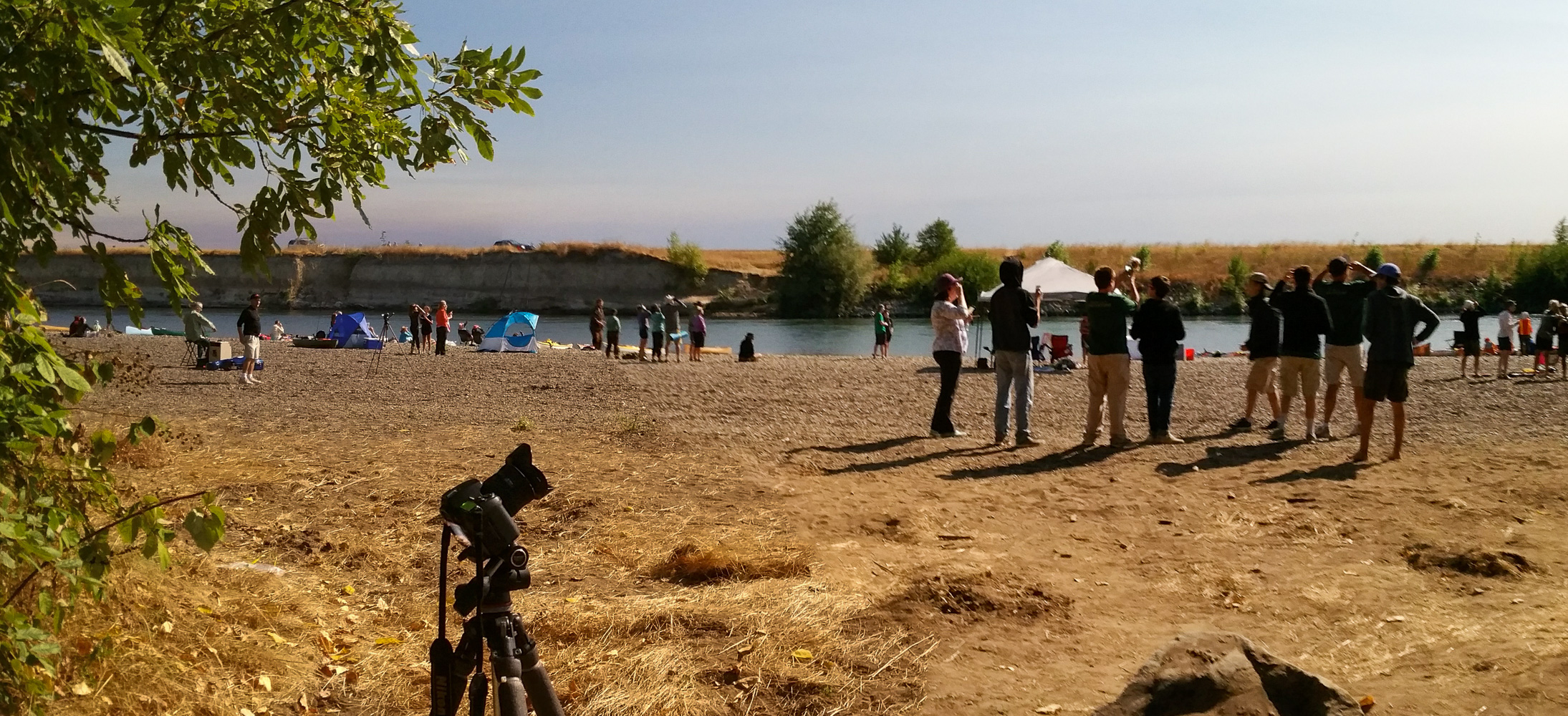The crowd watching totality. I should not have been on autoexposure as this looks like daylight when it wasn't. Notice the electric cello player over on the left side. He was hired to provide background music for the paddlers.