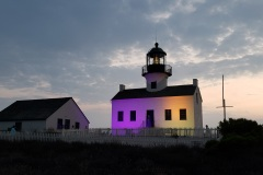 Cabrillo National Monument lite in purple in gold to commorate the passing in the 19th amendment for women's right to vote